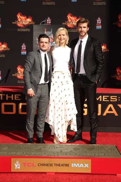 Josh Hutcherson, Jennifer Lawrence and Liam Hemsworth seen at The Hunger Games: Mockingjay Part 2 cast Hand and footprint ceremony at Hollywood Blvd. on Saturday, October 31, 2015, in Los Angeles, CA. (Photo by Eric Charbonneau/Invision for Lionsgate/AP Images)