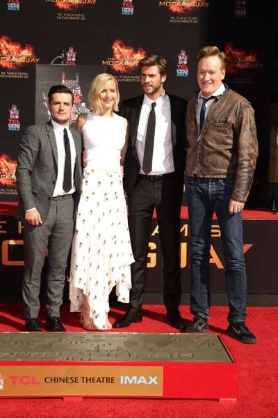 Josh Hutcherson, Jennifer Lawrence, Liam Hemsworth and Conan O'Brien seen at The Hunger Games: Mockingjay Part 2 cast Hand and footprint ceremony at Hollywood Blvd. on Saturday, October 31, 2015, in Los Angeles, CA. (Photo by Eric Charbonneau/Invision for Lionsgate/AP Images)
