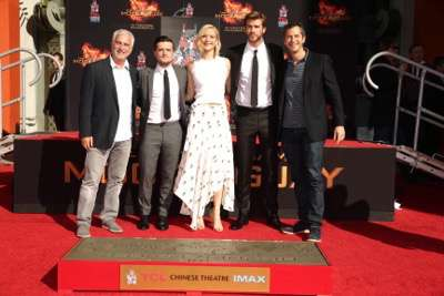 Rob Friedman, Co-Chairman of Lionsgate Motion Picture Group, Josh Hutcherson, Jennifer Lawrence, Liam Hemsworth and Erik Feig, Co-President of Lionsgate Motion Picture Group, seen at The Hunger Games: Mockingjay Part 2 cast Hand and footprint ceremony at Hollywood Blvd. on Saturday, October 31, 2015, in Los Angeles, CA. (Photo by Eric Charbonneau/Invision for Lionsgate/AP Images)