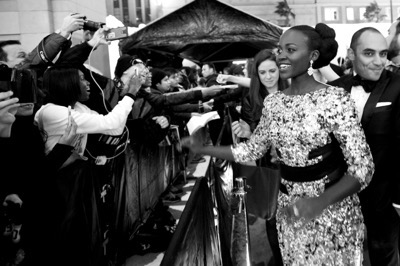 HOLLYWOOD, CA - DECEMBER 14: (EDITORS NOTE: Image has been shot in black and white. Color version not available.) Actress Lupita Nyong'o attends the World Premiere of ?Star Wars: The Force Awakens? at the Dolby, El Capitan, and TCL Theatres on December 14, 2015 in Hollywood, California.  (Photo by Charley Gallay/Getty Images for Disney) *** Local Caption *** Lupita Nyong'o