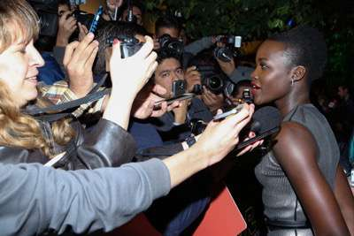 MEXICO CITY, MEXICO - DECEMBER 08: Actress Lupita Nyong'o attends the Fan Event and Q&A of Star Wars The Force Awakens at the Cinemex Antara In Mexico City, Mexico, December 08, 2015. The World Premiere will be the next December 18. (Photo by Victor Chavez/Getty Images for Walt Disney Studios)