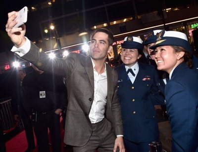 HOLLYWOOD, CA - JANUARY 25:  Actor Chris Pine and the cast of Disneyís ìThe Finest Hoursî were greeted by the U.S. Coast Guard Band, Honor Guard and throngs of fans at the filmís premiere earlier tonight at the TCL Chinese Theater on Hollywood Blvd. The heroic action-thriller opens in U.S. theaters this Friday, January 29.  (Photo by Alberto E. Rodriguez/Getty Images for Disney) *** Local Caption *** Chris Pine