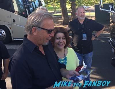 Kevin Costner signing autographs
