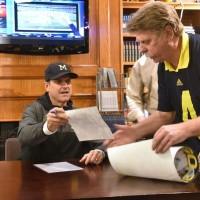 Jim Harbaugh signing autographs