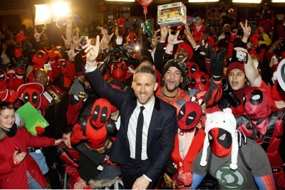 """{special instructions) {city}, NY - 20th Century Fox Presents the New York Fan Event for """"DEADPOOL"""". The Film Opens Nationwide on February 12th, 2016 -PICTURED: Ryan Reynolds with DEADPOOL Fans -PHOTO by: Marion Curtis/Starpix -Filename: MC_16_01061016.JPG -Location: AMC Empire Times Square Editorial - Rights Managed Image - Please contact www.startraksphoto.com for licensing fee Startraks Photo New York, NY Image may not be published in any way that is or might be deemed defamatory, libelous, pornographic, or obscene. Please consult our sales department for any clarification or question you may have. Startraks Photo reserves the right to pursue unauthorized users of this image. If you violate our intellectual property you may be liable for actual damages, loss of income, and profits you derive from the use of this image, and where appropriate, the cost of collection and/or statutory damages."""