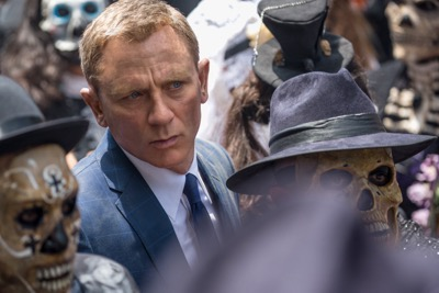 Bond (Daniel Craig) following Marco Sciarra through the Day of the Dead parade in Metro-Goldwyn-Mayer Pictures/Columbia Pictures/EON Productions' action adventure SPECTRE. 