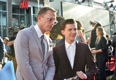 "HOLLYWOOD, CALIFORNIA - APRIL 12:  Actors Paul Bettany (L) and Tom Holland attend The World Premiere of Marvel's ""Captain America: Civil War"" at Dolby Theatre on April 12, 2016 in Los Angeles, California.  (Photo by Lester Cohen/Getty Images for Disney) *** Local Caption *** Paul Bettany; Tom Holland"