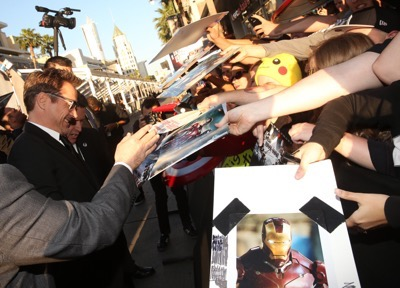 "HOLLYWOOD, CALIFORNIA - APRIL 12:  Actor Robert Downey Jr. signs autographs during The World Premiere of Marvel's ""Captain America: Civil War"" at Dolby Theatre on April 12, 2016 in Los Angeles, California.  (Photo by Jesse Grant/Getty Images for Disney) *** Local Caption *** Robert Downey Jr."