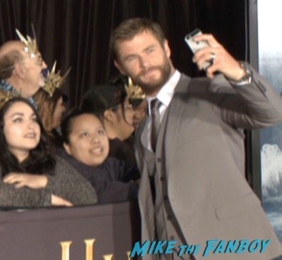 The huntsman los angeles premiere charlize theron signing autographs chris hemsworth3