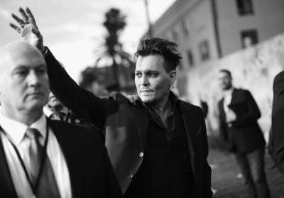 HOLLYWOOD, CA - MAY 23:  (EDITORS NOTE: Image has been shot in black and white. Color version not available.) Actor Johnny Depp attends Disneyís 'Alice Through the Looking Glass' premiere with the cast of the film, which included Johnny Depp, Anne Hathaway, Mia Wasikowska and Sacha Baron Cohen at the El Capitan Theatre on May 23, 2016 in Hollywood, California.  (Photo by Charley Gallay/Getty Images for Disney) *** Local Caption *** Johnny Depp
