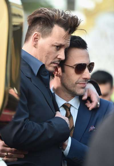 HOLLYWOOD, CA - MAY 23:  Actors Johnny Depp and Sacha Baron Cohen attend Disneyís 'Alice Through the Looking Glass' premiere with the cast of the film, which included Johnny Depp, Anne Hathaway, Mia Wasikowska and Sacha Baron Cohen at the El Capitan Theatre on May 23, 2016 in Hollywood, California.  (Photo by Alberto E. Rodriguez/Getty Images for Disney) *** Local Caption *** Johnny Depp; Sacha Baron Cohen