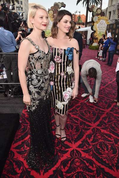 HOLLYWOOD, CA - MAY 23: Actresses Mia Wasikowska (L) and Anne Hathaway attend Disneyís 'Alice Through the Looking Glass' premiere with the cast of the film, which included Johnny Depp, Anne Hathaway, Mia Wasikowska and Sacha Baron Cohen at the El Capitan Theatre on May 23, 2016 in Hollywood, California.  (Photo by Alberto E. Rodriguez/Getty Images for Disney) *** Local Caption *** Mia Wasikowska; Anne Hathaway