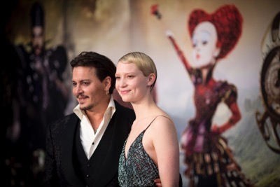 "LONDON UK : Johnny Depp and Mia Wasikowska, the stars  of Disney's ""Alice Through The Looking Glass,"" attend the European Premiere in London on 10th May 2016.  ( Credit : James Gillham / StingMedia )"