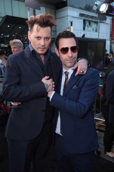 "Johnny Depp and Sacha Baron Cohen pose together at The US Premiere of Disney's ""Alice Through the Looking Glass"" at the El Capitan Theater in Los Angeles, CA on Monday, May 23, 2016."