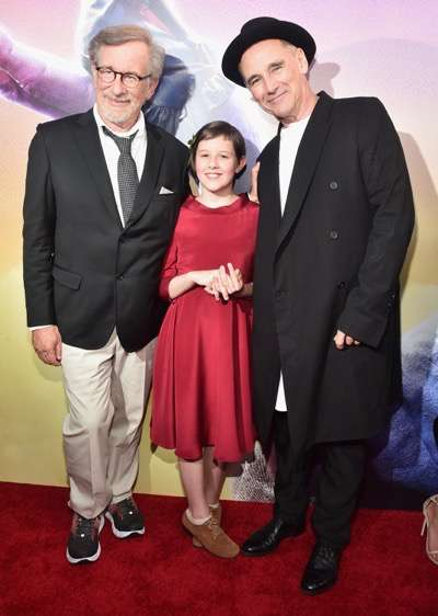 "HOLLYWOOD, CA - JUNE 21:  (L-R) Director Steven Spielberg, actors Ruby Barnhill and Mark Rylance arrive on the red carpet for the US premiere of Disney's ""The BFG,"" directed and produced by Steven Spielberg. A giant sized crowd lined the streets of Hollywood Boulevard to see stars arrive at the El Capitan Theatre. ""The BFG"" opens in U.S. theaters on July 1, 2016, the year that marks the 100th anniversary of Dahl's birth, at the El Capitan Theatre on June 21, 2016 in Hollywood, California.  (Photo by Alberto E. Rodriguez/Getty Images for Disney) *** Local Caption *** Steven Spielberg; Ruby Barnhill; Mark Rylance"