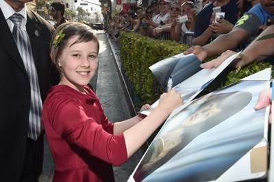"HOLLYWOOD, CA - JUNE 21:  Actress Ruby Barnhill arrives on the red carpet for the US premiere of Disney's ""The BFG,"" directed and produced by Steven Spielberg. A giant sized crowd lined the streets of Hollywood Boulevard to see stars arrive at the El Capitan Theatre. ""The BFG"" opens in U.S. theaters on July 1, 2016, the year that marks the 100th anniversary of Dahl's birth, at the El Capitan Theatre on June 21, 2016 in Hollywood, California.  (Photo by Alberto E. Rodriguez/Getty Images for Disney) *** Local Caption *** Ruby Barnhill"