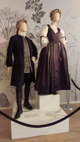 Jamie Fraser (Silk wool suit with grey silk embroidered waistcoat) and Claire Fraser (18th c/1940's grey silk day dress with white organza sleeves and antique chatelaine)