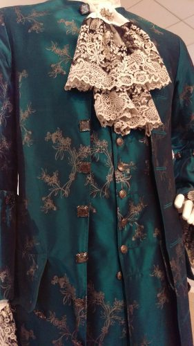 Front Details: Comte St. Germain (Turquoise hand-painted silk suit)