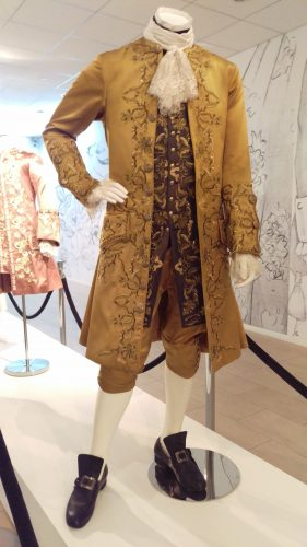Comte St. Germain (Gold embroidered silk suit with purple waistcoat)