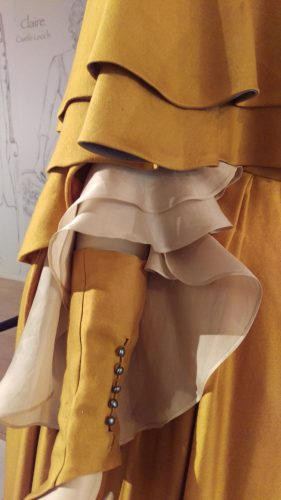 Side Details: Claire Fraser (Saffron silk gown and cape)