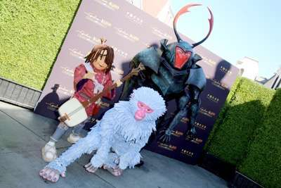 """Kubo, Monkey and Beetle seen at Focus Features Los Angeles Premiere of LAIKA """"Kubo and The Two Strings"""" on Sunday, Aug. 14, 2016, in Universal City, Calif. (Photo by Blair Raughley/Invision for Focus Features/AP Images)"""