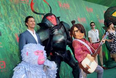 """Monkey, Matthew McConaughey, Beetle and Kubo seen at Focus Features Los Angeles Premiere of LAIKA """"Kubo and The Two Strings"""" on Sunday, Aug. 14, 2016, in Universal City, Calif. (Photo by Blair Raughley/Invision for Focus Features/AP Images)"""