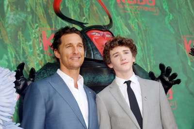"""Matthew McConaughey, Beetle and Art Parkinson seen at Focus Features Los Angeles Premiere of LAIKA """"Kubo and The Two Strings"""" on Sunday, Aug. 14, 2016, in Universal City, Calif. (Photo by Blair Raughley/Invision for Focus Features/AP Images)"""