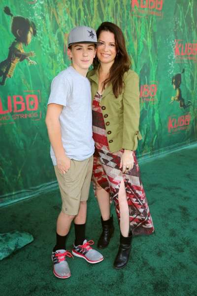 """Finley Arthur Donoho and Holly Marie Combs seen at Focus Features Los Angeles Premiere of LAIKA """"Kubo and The Two Strings"""" on Sunday, Aug. 14, 2016, in Universal City, Calif. (Photo by Blair Raughley/Invision for Focus Features/AP Images)"""