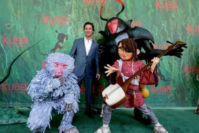 """Monkey, Matthew McConaughey, Beetle and Kubo seen at Focus Features Los Angeles Premiere of LAIKA """"Kubo and The Two Strings"""" on Sunday, Aug. 14, 2016, in Universal City, Calif. (Photo by Eric Charbonneau/Invision for Focus Features/AP Images)"""
