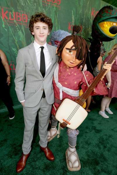 """Art Parkinson and Kubo seen at Focus Features Los Angeles Premiere of LAIKA """"Kubo and The Two Strings"""" on Sunday, Aug. 14, 2016, in Universal City, Calif. (Photo by Eric Charbonneau/Invision for Focus Features/AP Images)"""