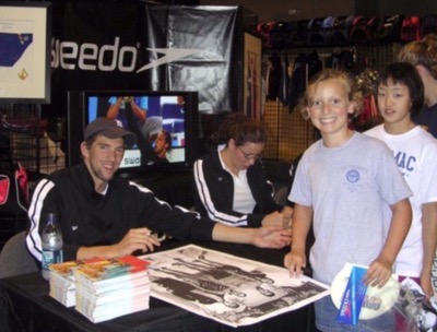 Katie Ledecky getting michael phelps autograph when she was nine 1