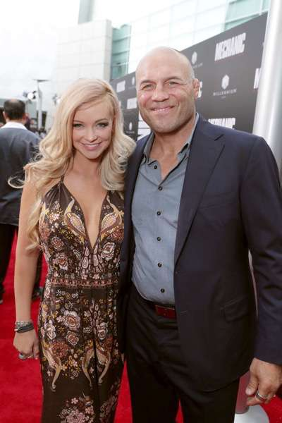 """Mindy Robinson and Randy Couture seen at Los Angeles Premiere of """"Mechanic: Resurrection"""" from Lionsgate's Summit Premiere Label at ArcLight Hollywood on Monday, Aug. 22, 2016, in Los Angeles. (Photo by Eric Charbonneau/Invision for Lionsgate/AP Images)"""