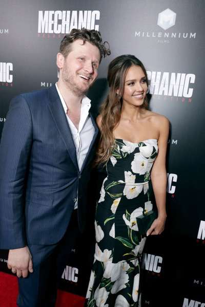 """Director Dennis Gansel and Jessica Alba seen at Los Angeles Premiere of """"Mechanic: Resurrection"""" from Lionsgate's Summit Premiere Label at ArcLight Hollywood on Monday, Aug. 22, 2016, in Los Angeles. (Photo by Eric Charbonneau/Invision for Lionsgate/AP Images)"""