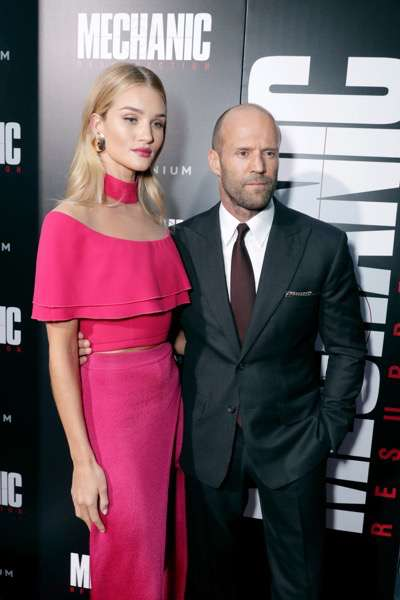 """Rosie Huntington-Whiteley and Jason Statham seen at Los Angeles Premiere of """"Mechanic: Resurrection"""" from Lionsgate's Summit Premiere Label at ArcLight Hollywood on Monday, Aug. 22, 2016, in Los Angeles. (Photo by Eric Charbonneau/Invision for Lionsgate/AP Images)"""
