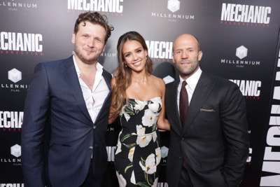 """Director Dennis Gansel, Jessica Alba and Jason Statham seen at Los Angeles Premiere of """"Mechanic: Resurrection"""" from Lionsgate's Summit Premiere Label at ArcLight Hollywood on Monday, Aug. 22, 2016, in Los Angeles. (Photo by Eric Charbonneau/Invision for Lionsgate/AP Images)"""