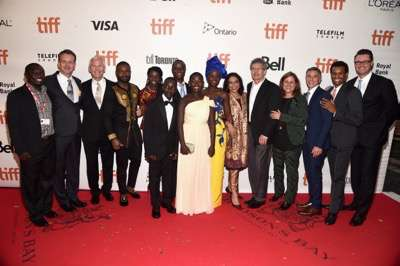 TORONTO, ON - SEPTEMBER 10: (L-R) Mark Mugwana, President of Walt Disney Studios Motion Picture Production, Sean Bailey, producer John Carls, actor David Oyelowo, Ugandan national chess champion Phiona Mutesi, actor Martin Kabanza, Chess Coach and Director of Sports Outreach in Uganda, Robert Katende, actors Madina Nalwanga, Lupita Nyong'o, director Mira Nair, Chairman, The Walt Disney Studios, Alan Horn, producer Lydia Pilcher, President, Marketing, The Walt Disney Studios, Ricky Strauss, Executive Vice President of Production, The Walt Disney Studios, Tendo Nagenda and EVP, Distribution at The Walt Disney Company, Dave Hollis arrive at the world premiere of Disneyís ìQueen of Katweî at Roy Thompson Hall as part of the 2016 Toronto Film Festival where the cast, filmmakers and real life stars received a standing ovation. The film, starring David Oyelowo, Oscar winner Lupita Nyongío and newcomer Madina Nalwanga, is directed by Mira Nair and opens in U.S. Theaters September 23, 2017.  (Photo by Alberto E. Rodriguez/Getty Images for Disney ) *** Local Caption *** Mark Mugwana; Sean Bailey; John Carls; David Oyelowo; Phiona Mutesi; Martin Kabanza; Robert Katende; Madina Nalwanga; Lupita Nyong'o; Mira Nair; Alan Horn; Lydia Pilcher; Ricky Strauss; Tendo Nagenda; Dave Hollis