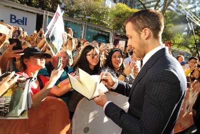 "Ryan Gosling signs autographs at Summit Entertainment's ""La La Land"" premiere at the 2016 Toronto International Film Festival on Monday, Sept. 12, 2016, in Toronto. (Photo by Eric Charbonneau/Invision for LionsgateAP Images)"