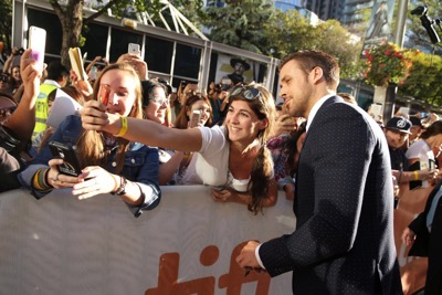 "Ryan Gosling poses for a selfie at Summit Entertainment's ""La La Land"" premiere at the 2016 Toronto International Film Festival on Monday, Sept. 12, 2016, in Toronto. (Photo by Eric Charbonneau/Invision for LionsgateAP Images)"
