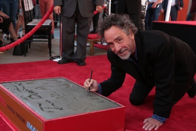 "Tim Burton celebrates at his Hand & Footprint Ceremony presented by 20th Century Fox in celebration of his newest film ""Miss Peregrine's Home for Peculiar Children"" at the TCL Chinese Theatre in Los Angeles, CA on September 8, 2016. (Photo: Alex J. Berliner/ABImages)"
