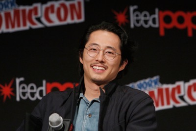 NEW YORK, NY - OCTOBER 08: Actor Steven Yeun speaks onstage as Netflix presents Dreamworks Trollhunters during New York Comic Con at Madison Square Garden on October 8, 2016 in New York City.  (Photo by Lars Niki/Getty Images for Netflix) *** Local Caption *** Steven Yeun
