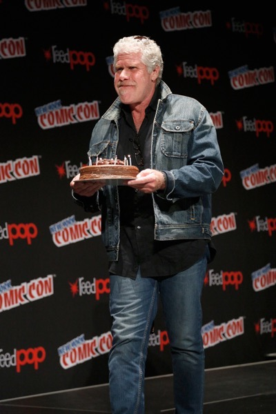 NEW YORK, NY - OCTOBER 08: Actor Ron Perlman brings out a birthday cake for Guillermo del Toro onstage as Netflix presents Dreamworks Trollhunters during New York Comic Con at Madison Square Garden on October 8, 2016 in New York City.  (Photo by Lars Niki/Getty Images for Netflix) *** Local Caption *** Ron Perlman