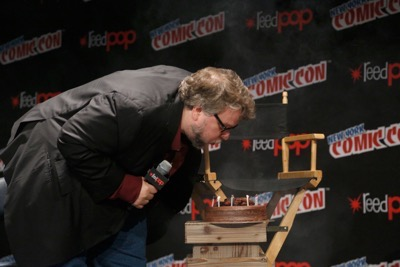 NEW YORK, NY - OCTOBER 08:  Creator and executive producer Guillermo del Toro blows out the candles on his birthday cake onstage as Netflix presents Dreamworks Trollhunters during New York Comic Con at Madison Square Garden on October 8, 2016 in New York City.  (Photo by Lars Niki/Getty Images for Netflix) *** Local Caption *** Guillermo del Toro
