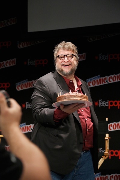 NEW YORK, NY - OCTOBER 08: Creator and executive producer Guillermo del Toro poses for a photo onstage with his birthday cake as Netflix presents Dreamworks Trollhunters during New York Comic Con at Madison Square Garden on October 8, 2016 in New York City.  (Photo by Lars Niki/Getty Images for Netflix) *** Local Caption *** Guillermo del Toro