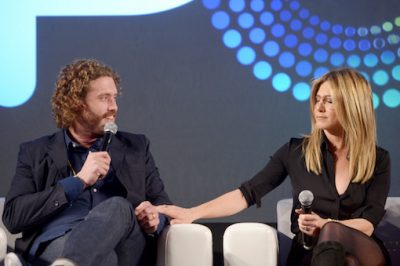 "LOS ANGELES, CA - OCTOBER 30: Actors T.J. Miller (L) and Jennifer Aniston speak onstage during the ""Stars of Office Christmas Party"" panel at Entertainment Weekly's PopFest at The Reef on October 30, 2016 in Los Angeles, California. (Photo by Matt Winkelmeyer/Getty Images for Entertainment Weekly)"