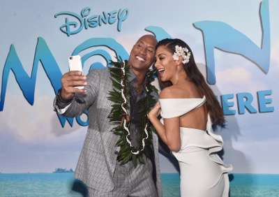 """HOLLYWOOD, CA - NOVEMBER 14:  Actors Dwayne Johnson (L) and Nicole Scherzinger attend The World Premiere of Disneyís """"MOANA"""" at the El Capitan Theatre on Monday, November 14, 2016 in Hollywood, CA.  (Photo by Alberto E. Rodriguez/Getty Images for Disney) *** Local Caption *** Nicole Scherzinger; Dwayne Johnson"""