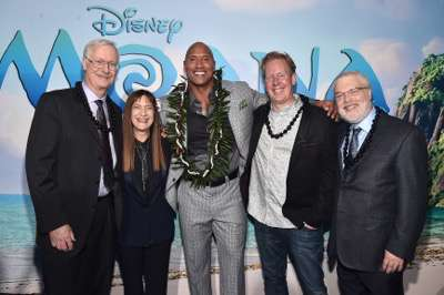 "HOLLYWOOD, CA - NOVEMBER 14:  (L-R) Co-director John Musker, Producer Osnat Shurer, actor Dwayne Johnson, Screenwriter Jared Bush and Co-Director Ron Clements attend The World Premiere of Disneyís ""MOANA"" at the El Capitan Theatre on Monday, November 14, 2016 in Hollywood, CA.  (Photo by Alberto E. Rodriguez/Getty Images for Disney) *** Local Caption *** John Musker; Osnat Shurer; Dwayne Johnson; Jared Bush; Ron Clements"