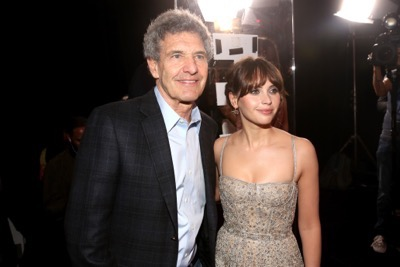 "HOLLYWOOD, CA - DECEMBER 10:  Chairman, The Walt Disney Studios, Alan Horn (L) and actress Felicity Jones attend The World Premiere of Lucasfilm's highly anticipated, first-ever, standalone Star Wars adventure, ""Rogue One: A Star Wars Story"" at the Pantages Theatre on December 10, 2016 in Hollywood, California.  (Photo by Jesse Grant/Getty Images for Disney) *** Local Caption *** Alan Horn; Felicity Jones"