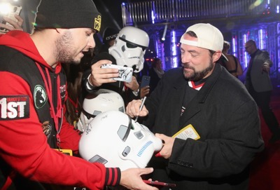 "HOLLYWOOD, CA - DECEMBER 10:  Filmmaker Kevin Smith (R) attends The World Premiere of Lucasfilm's highly anticipated, first-ever, standalone Star Wars adventure, ""Rogue One: A Star Wars Story"" at the Pantages Theatre on December 10, 2016 in Hollywood, California.  (Photo by Jesse Grant/Getty Images for Disney) *** Local Caption *** Kevin Smith"