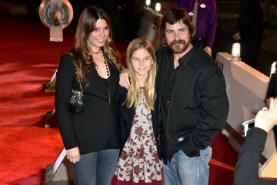 """HOLLYWOOD, CA - DECEMBER 10: (L-R) Actress Sibi Blazic, guest and ctor Christian Bale attend The World Premiere of Lucasfilm's highly anticipated, first-ever, standalone Star Wars adventure, """"Rogue One: A Star Wars Story"""" at the Pantages Theatre on December 10, 2016 in Hollywood, California.  (Photo by Marc Flores/Getty Images for Disney) *** Local Caption *** Sibi Blazic; Christian Bale"""