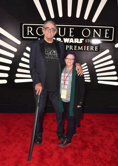 "HOLLYWOOD, CA - DECEMBER 10: Actor Peter Mayhew (L) and Angie Mayhew attend The World Premiere of Lucasfilm's highly anticipated, first-ever, standalone Star Wars adventure, ""Rogue One: A Star Wars Story"" at the Pantages Theatre on December 10, 2016 in Hollywood, California.  (Photo by Earl Gibson III/Getty Images for Disney) *** Local Caption *** Peter Mayhew; Angie Mayhew"